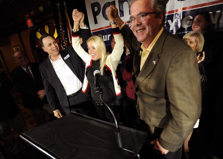 Florida Attorney General Pam Bondi, Center, Raises Her Arms Along With Sen.  Tom Lee, Left, And Former Florida Gov. Jeb Bush During A Rally In Tampa A  Day ...