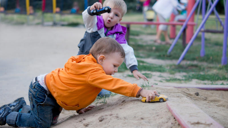 small boys playing outside
