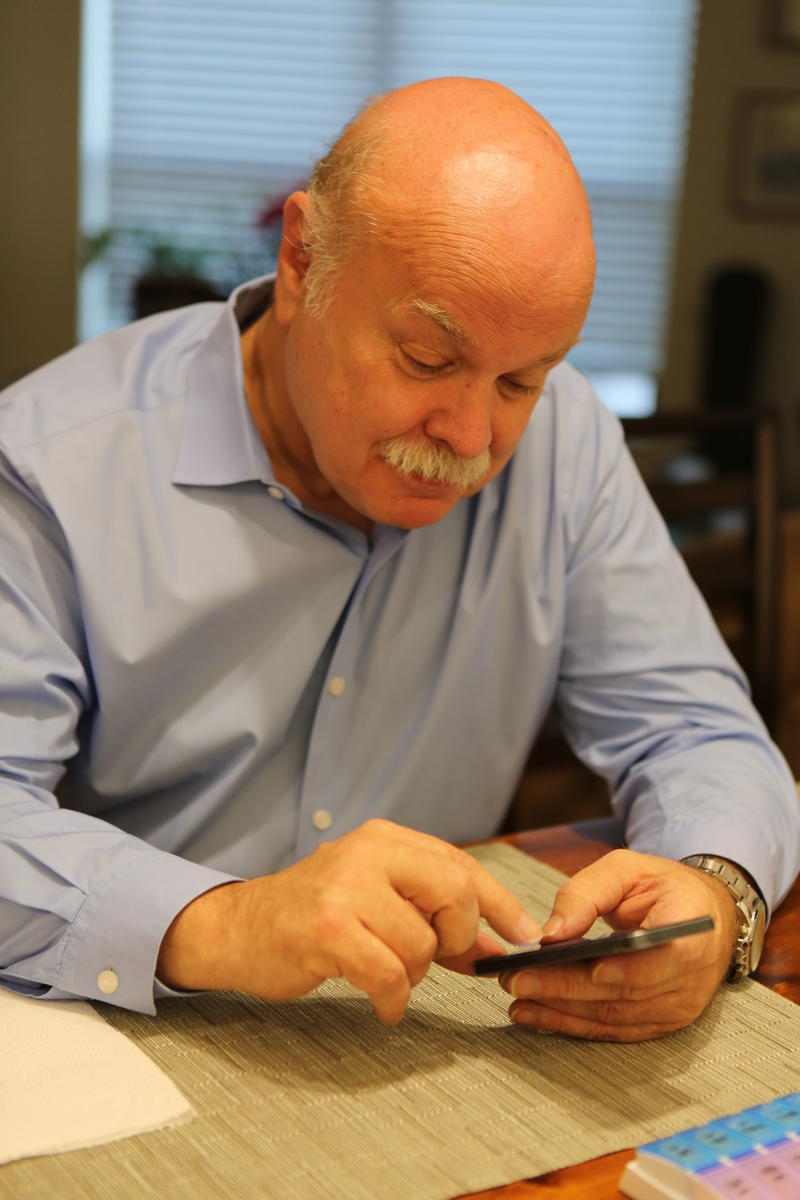 Dr. David Flockhart sending a text.