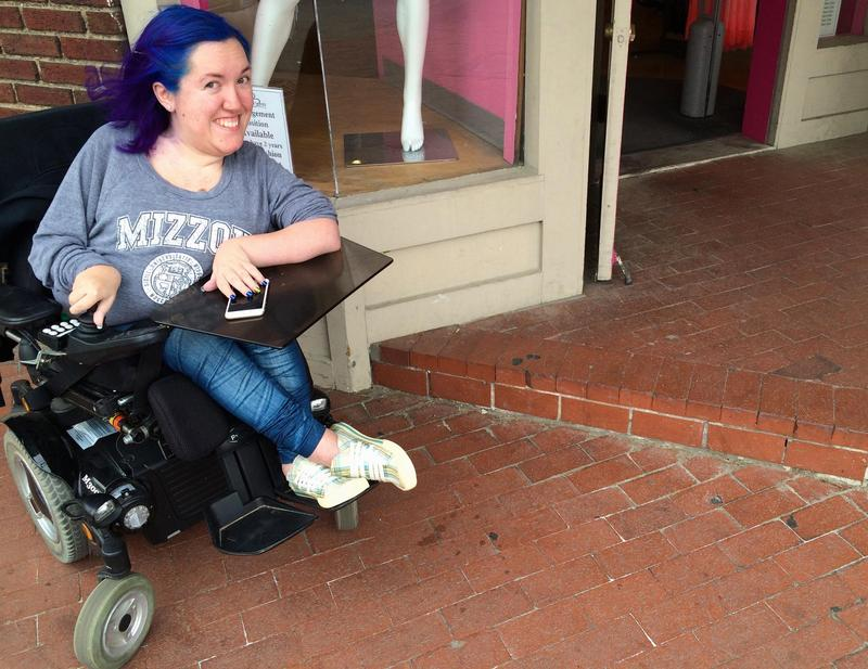 Gabriela Garbero poses outside Britches Clothing, in Columbia, Mo., while she is beta testing the accessibility app Compeer.
