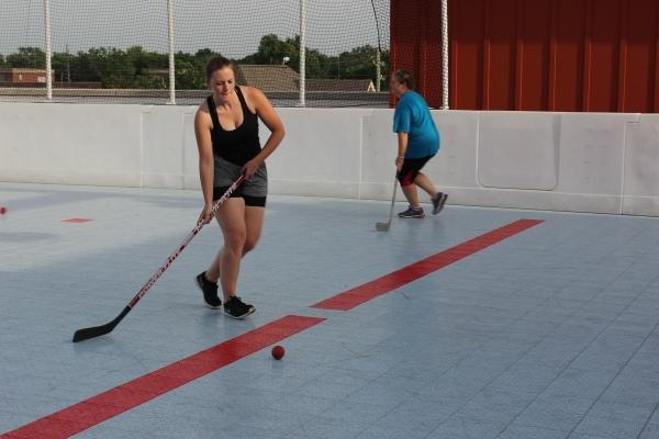Players warm up before a game at a rink on the roof of an apartment building in the Englewood neighborhood of IndIanapolis.