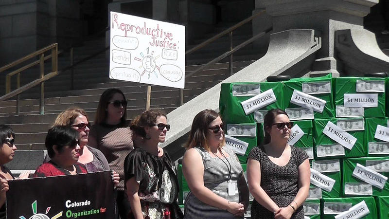 Women and health advocates held a rally at the Capitol to urge approval of a program that provides IUDs and long-acting birth control devices to young women