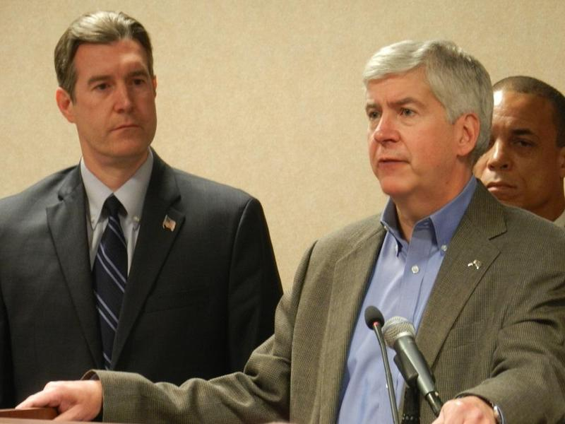 Michigan Governor Rick Snyder announces his support for a return to Detroit water at a Flint news conference.