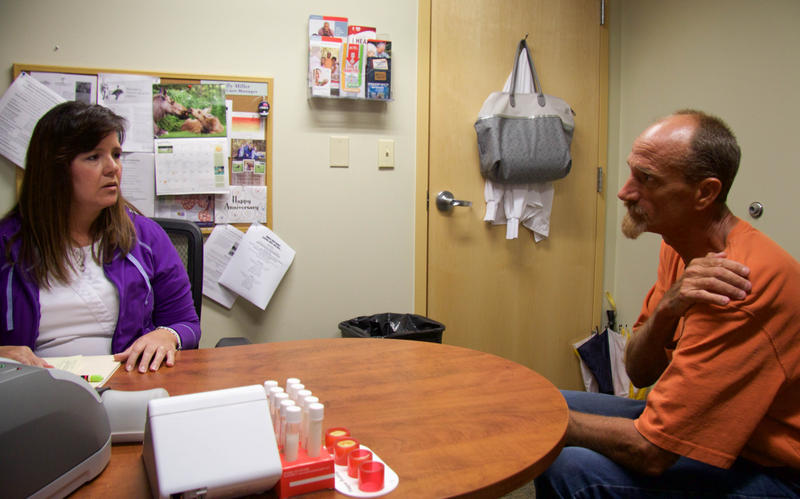 Harold Abernathy (right) meets with Kelly Miller, his nurse care manager at Crider Health Center in Missouri.