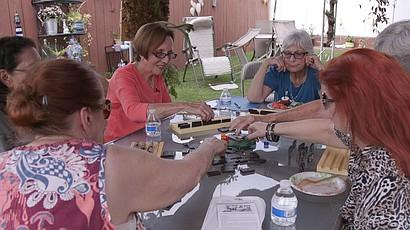 Agnes Conradt and Evie Kosower play Mexican train with their neighbors, Oct. 12, 2015.