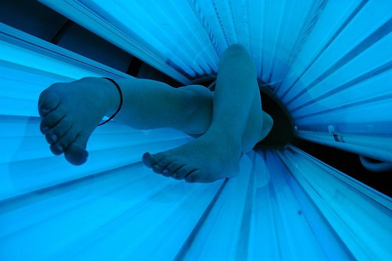 Exposure to ultraviolet rays, as in a tanning bed, is one well-known extrinsic factor that can lead to cancer. But there may be many factors scientists don't yet know about.