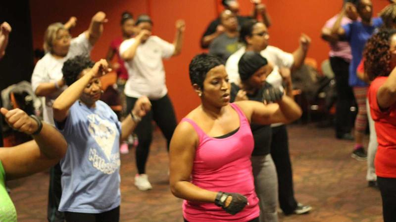 Fitness instructor Nicki Jones leads an exercise class at Lucile H. Bluford Library in Kansas City.