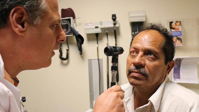 Martin Machain has his eyes examined in a doctor's office.