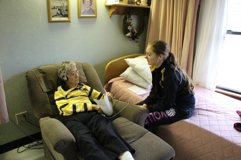 ent at Linn High School, helps Beverly Milburn with her music selection at Linn Community Nursing Home. Beier and other students volunteer with the program, which uses music to soothe people with Alzheimer's disease.