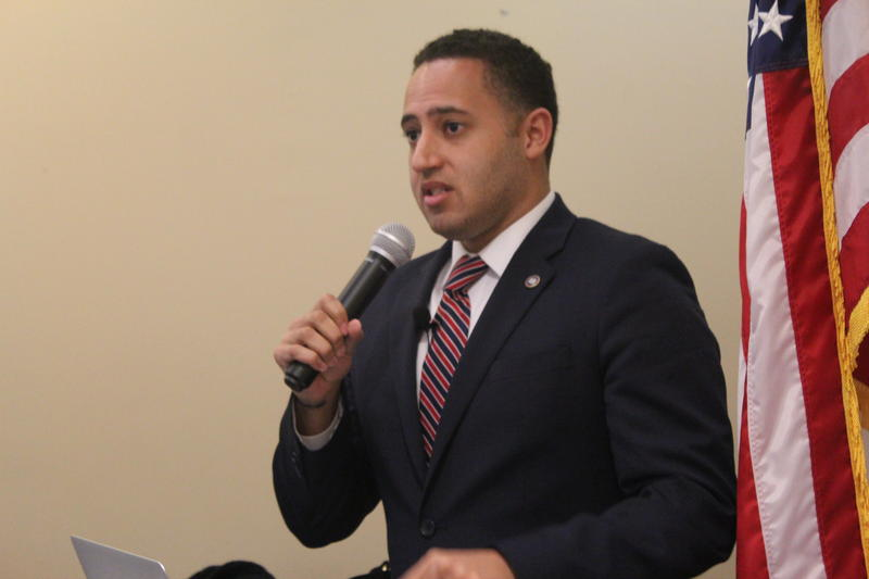 Svante Myrick speaking at a press conference.