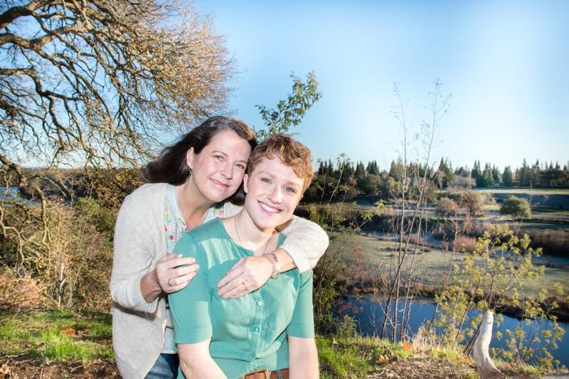 Pam Lipp hugging her daughter Amanda. Both are smiling at the camera.