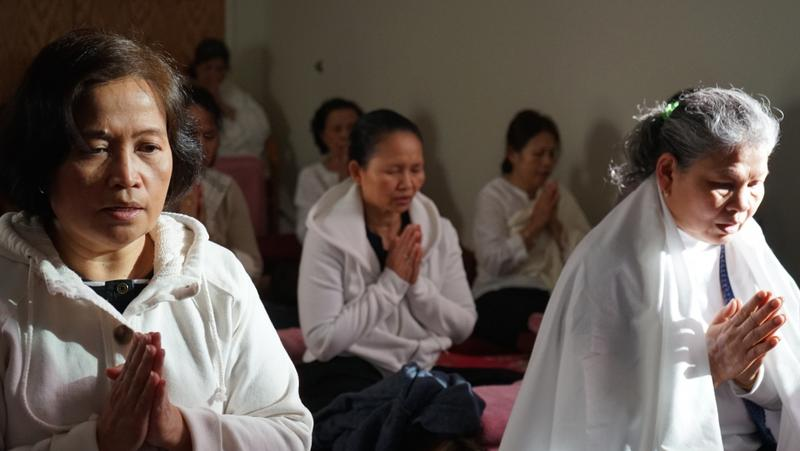 Women gather to meditate at the Metta Health Center in Lowell MA.