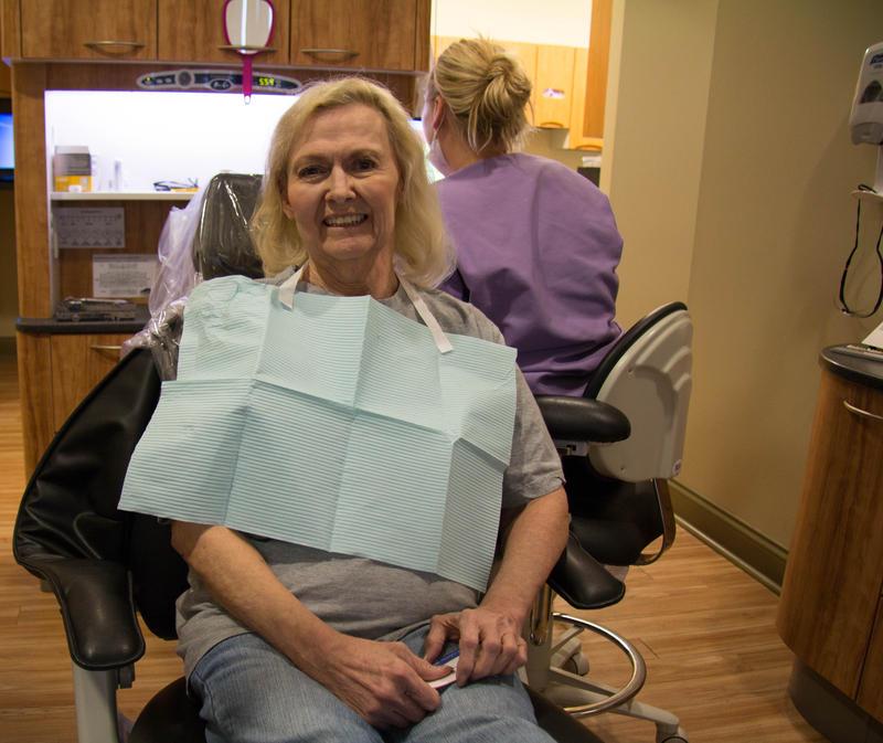 Aneita McCloskey sits in a dental chair at the COMTREA health center in Hillsboro, Mo.
