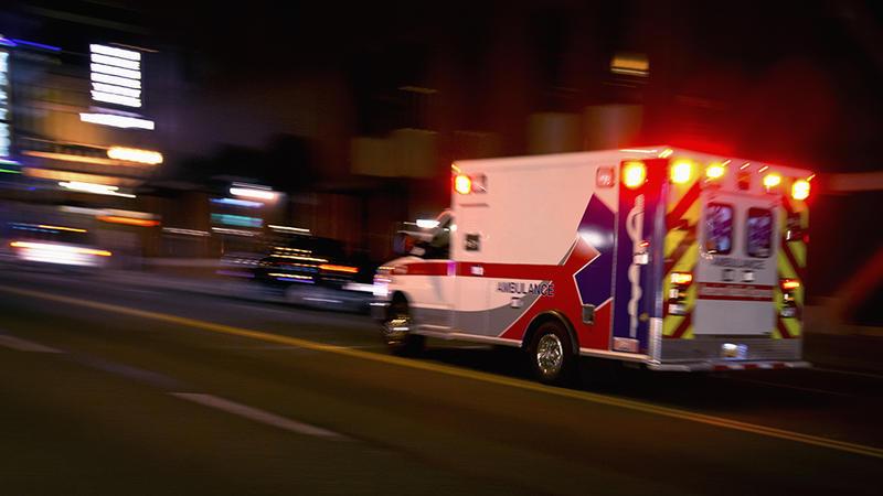 An ambulance driving fast