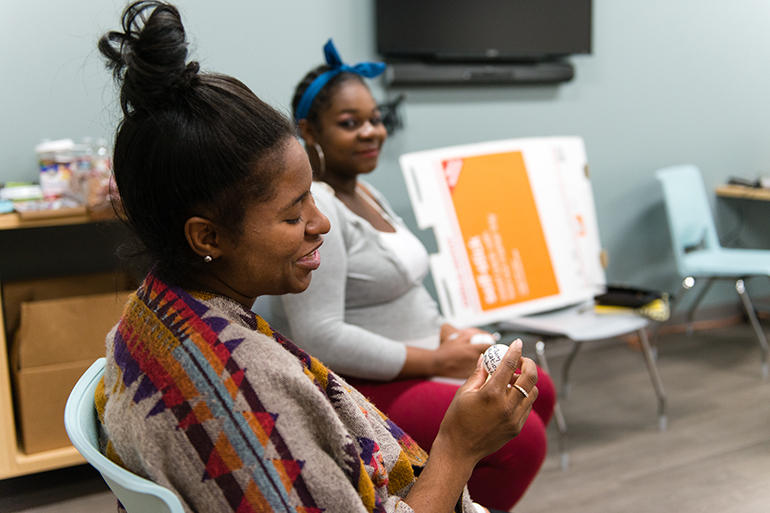 Anjik Butler and Alexandria Smith share their pregnancy concerns during a group session at the Eisner's Women's Health Center in Los Angeles. Shared medical appointments are becoming more common as a way to cut costs and improve efficiency.