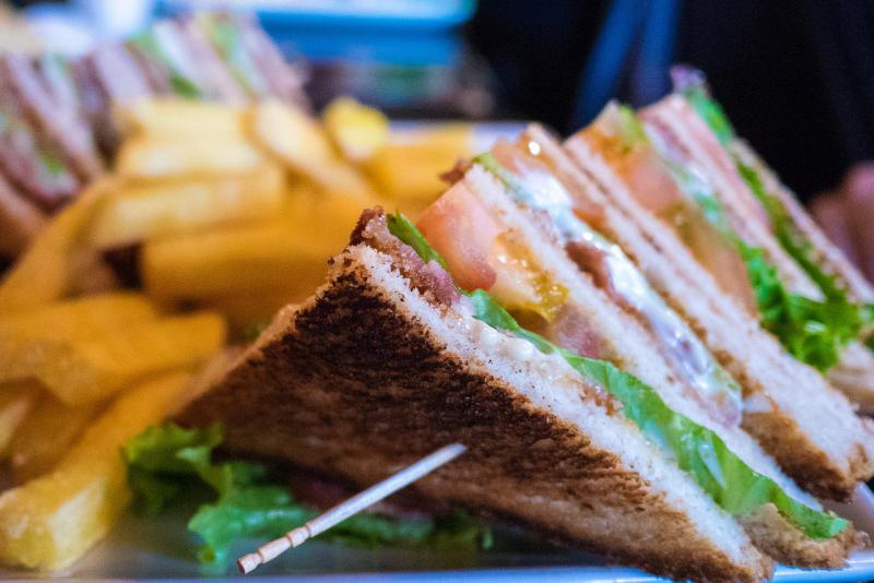 a club sandwich with fries
