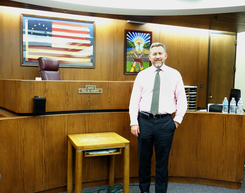 Judge Paul Herbert stands in his courtroom after one of the court's weekly sessions.