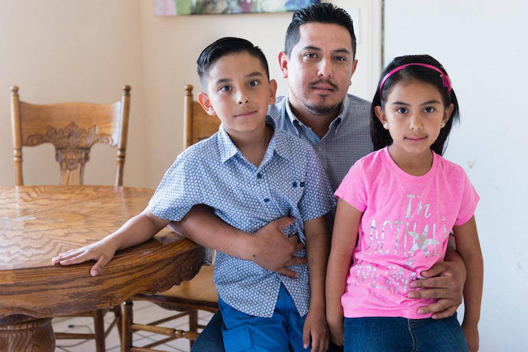 Benito Salgado, 33, and his children Benito, 9, and Stephanie, 7, at their house in Los Angeles, Calif., on May 31, 2016. Despite being aware of the risks, Salgado and his family do not have a disaster emergency kit.