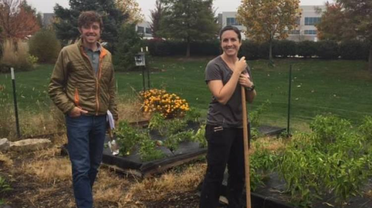 Claire Lane and Andrew Fritz work at the garden at St. Christopher's Episcopal Church.