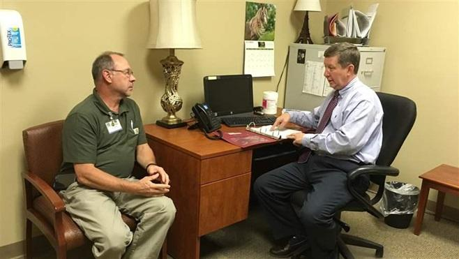 Dr. Michael Wilkerson discusses a patient's case with a nurse at a Bradford Health Services addiction treatment facility in Warrior, Alabama. When doctors become addicted to drugs or alcohol, confidential state programs must balance doctors' welfare and p