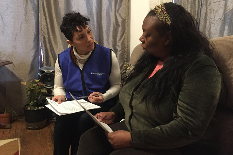 Dr. Kathy Tossas-Milligan (left), an epidemiologist with the University of Illinois at Chicago, interviews Yolanda Flowers as part of a pilot project to study the high infant mortality rate in Chicago's Englewood neighborhood.