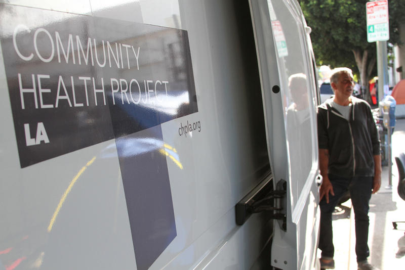 MIchael Marquesen, executive director of the Los Angeles Community Health Project, helps run a needle exchange program out of a white van in the SKid Row neighborhood every Monday morning.