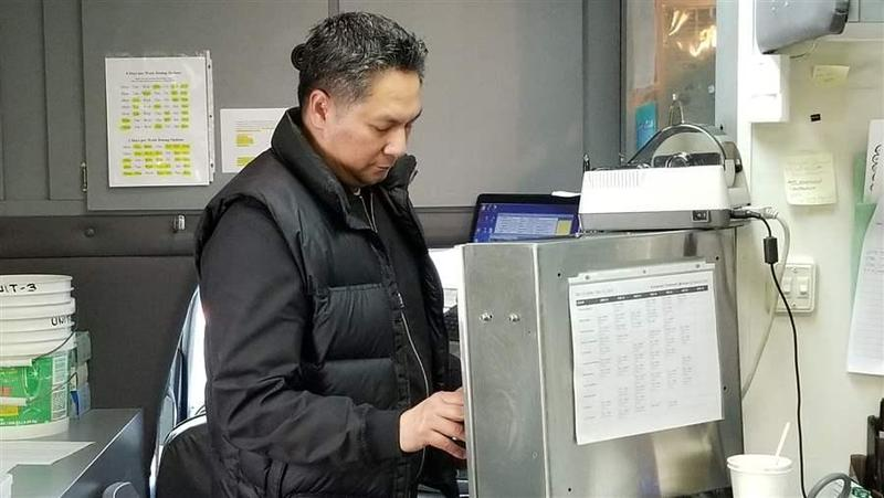 Julius Tiangson, a registered nurse, dosing a patient in a methadone van operated by Evergreen Treatment Services in Seattle. As the opioid epidemic spirals, more treatment centers want to add mobile clinics to their operations to serve more people.