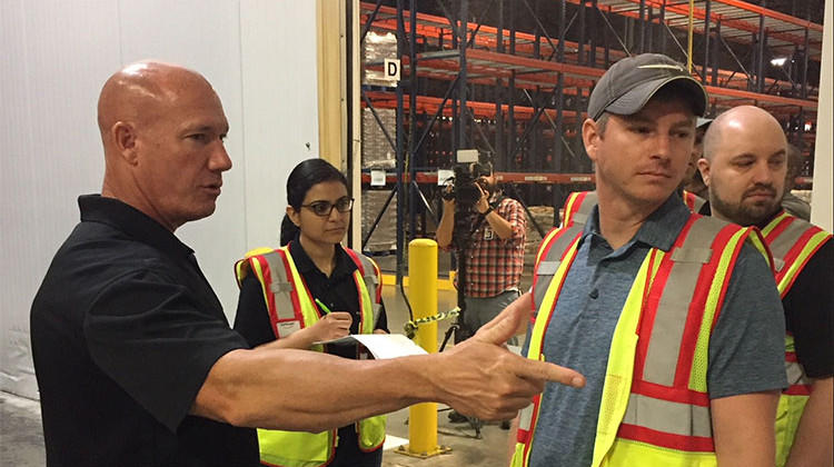 Gleaners COO and CFO Joe Slater (left) gives Amazon employees a tour of the freezer.