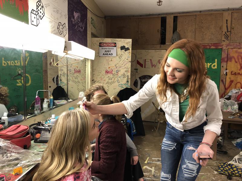 Abby Parmelee applies makeup to her friend McKenna Meyers before a play at Richwoods High School in Peoria, Illinois. Parmelee, who's 18, came out as a transgender woman to her entire school her junior year.