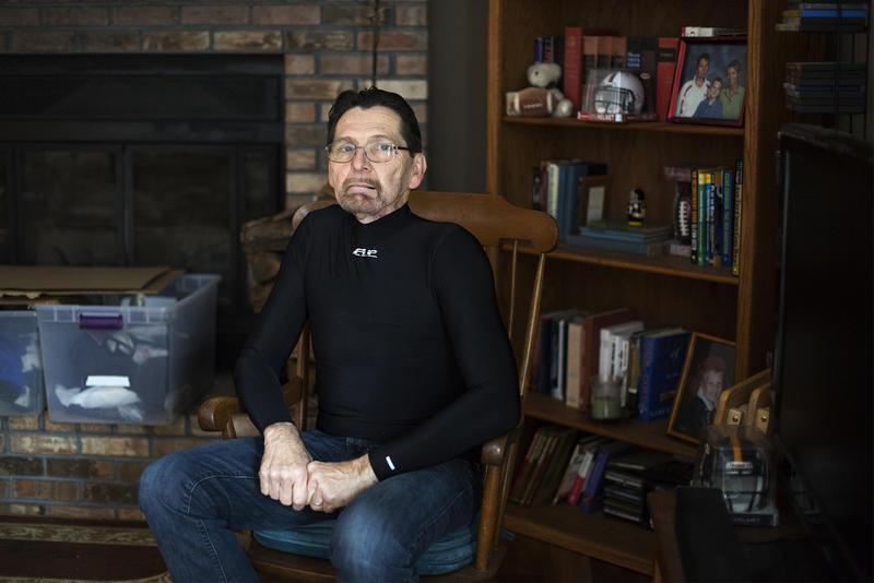 Cancer survivor Jim Nace poses in his Ballwin, Missouri, home.