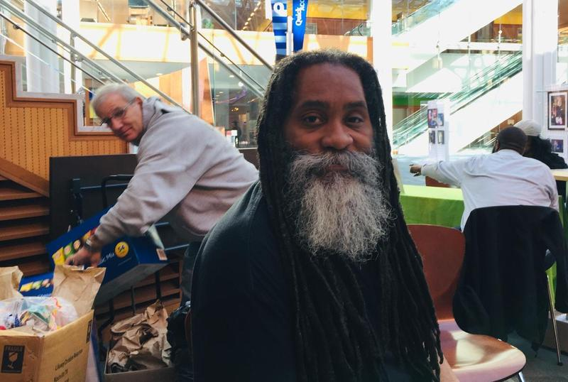 Maurice Young hands out lunches at an Indianapolis library. He also helps people navigate health insurance.