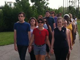 9/11 Memorial Event Organizer and FGCU Professor Lynn Neuman on a Remembrance and Refection Walk with FGCU students and staff