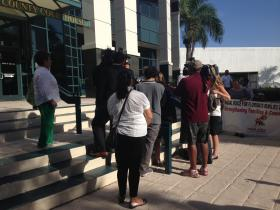 Advocates and press gather outside the Collier County Courtroom on Monday.