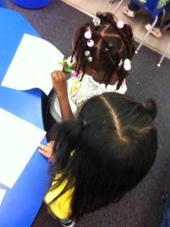 Itzel Lugo helps her fellow student.