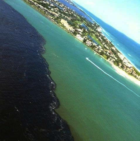 The darker lake water bears down on the aquamarine Indian River Lagoon in this 2013 photo.