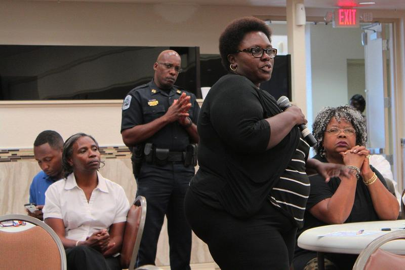 Crystal Johnson shares her thoughts on the relationship between police and the public at Thursday's meeting.