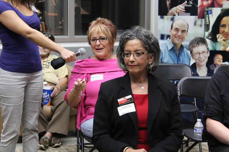 Carmen Salome, front, listens as Arlene Goldberg speaks during the show.