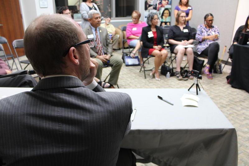 Host John Davis moderates the discussion.