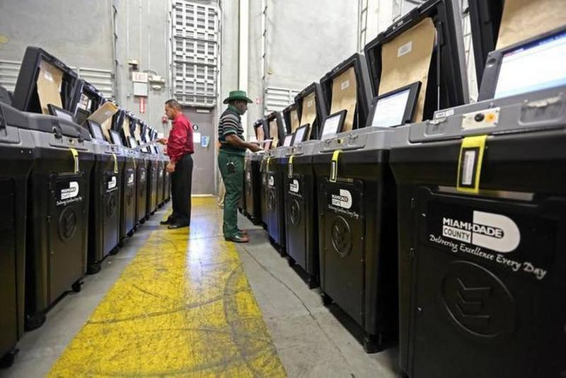 Miami-Dade elections workers test ballot machines in preparation for early voting in November 2014.