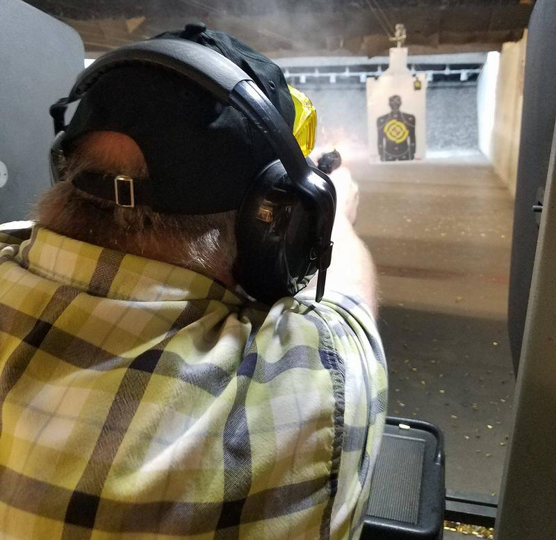 Chad Hendrix, the founder of the Fort Myers Pink Pistols chapter, practices his aim.