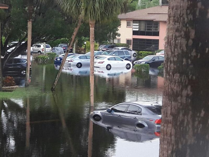 The Royal Woods community parking lot on Monday, when floodwaters reached up to four feet high.