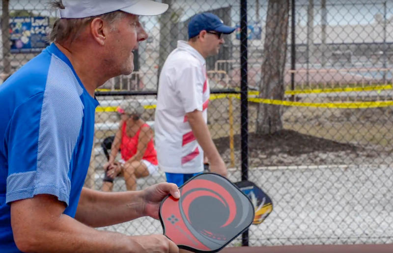 Two men play pickleball at East Naples Community park.