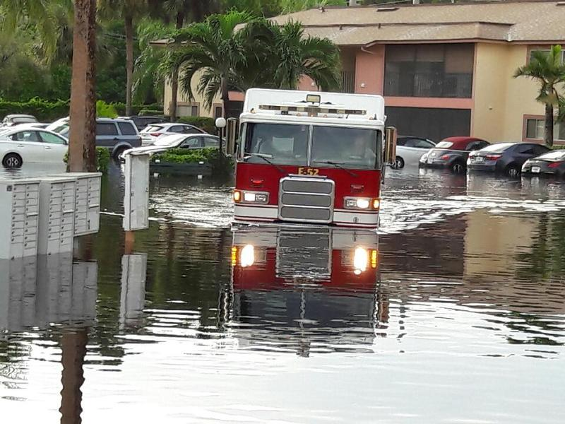 San Carlos Fire District using brush trucks to rescue voluntary evacuees Monday in the Royal Woods community, off of Island Park Road.