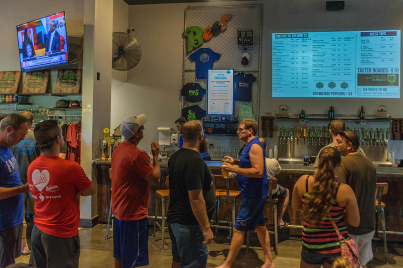 People wait in line at the bar of Fort Myers Brewing Company two days after the eye of Hurricane Irma passed over Southwest Florida.