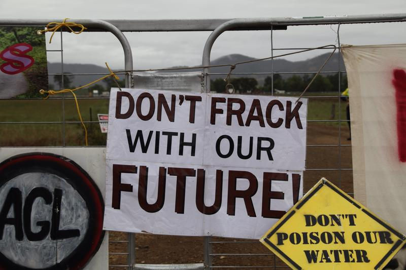 Signs on the gate of a fracking site
