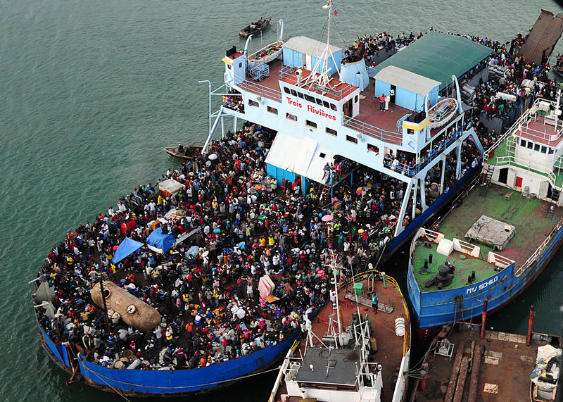 Haitians fill a ferry in Port-au-Prince after the 2010 earthquake.