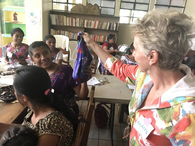Fort Myers resident Andrea Parrot handing a menstrual kit to a young Guatemalan woman.