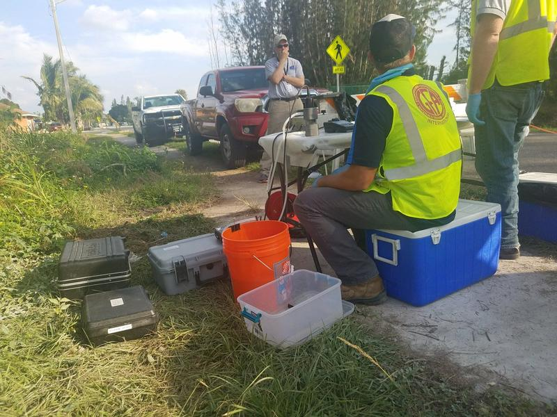 Geologists from a company hired by Fort Myers tests water from around the dumpsite this week. Results should be available in January.