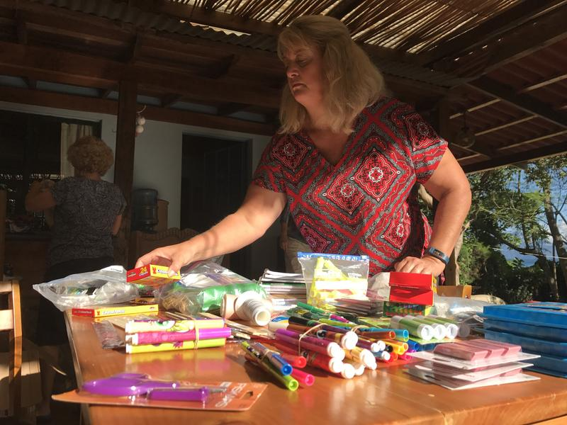 Kim Watson sorts through the school supplies she brought from Fort Myers to Guatemala to hand out as prizes for the sex education workshop activities.