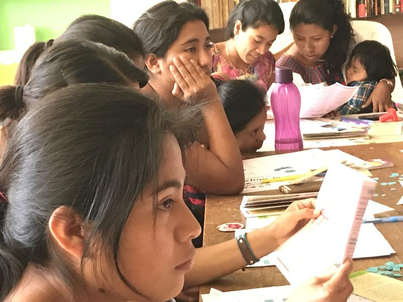 Guatemalan women ages 8 to 41 participating in a sex education workshop held in their village of San Juan la Laguna. These kinds of health talks are said to be taboo in this area.
